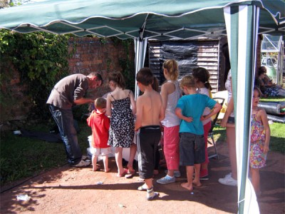 Queue for Glitter Tattoos at Cots for Tots fun-day